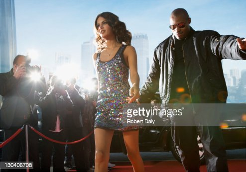 Bodyguard protecting celebrity on red carpet : Stock Photo