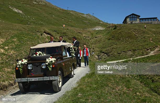 Bodyguards hang on to the Land Rover Defender transporting newlyweds Boris Becker and Sharlely Becker to their wedding brunch reception at the El...