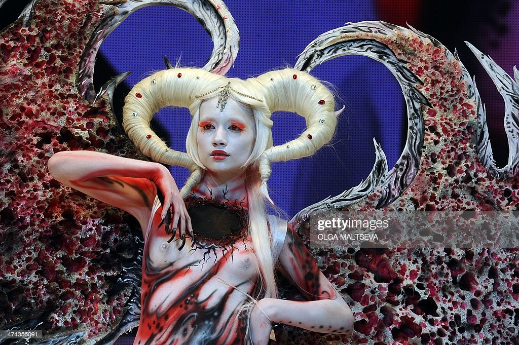 A body-painted model displays a creation during an art show as part of the International Beauty Expo 'Nevskie Berega' (Neva River Banks) in St.Petersburg on February 22, 2014. AFP PHOTO OLGA MALTSEVA
