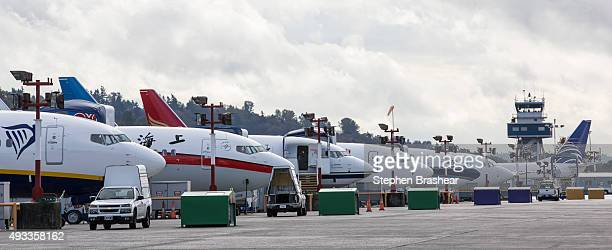Boeing 737 airplanes sit on the flight linge at Boeing on October 19 2015 in Seattle Washington Boeing celebrated the grand opening of its new 737...