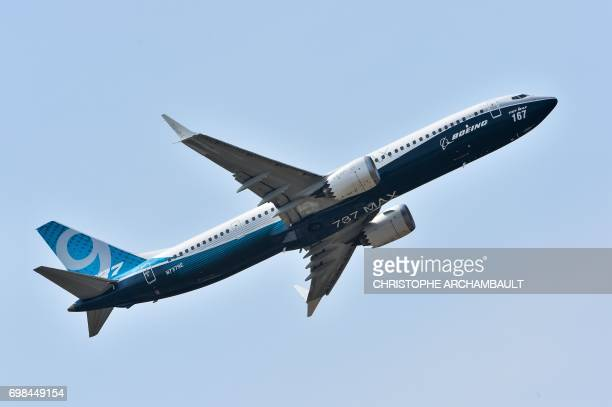 A Boeing 737 Max 9 jet airliner performs its flight display at Le Bourget on June 20 2017 during the International Paris Air Show / AFP PHOTO /...