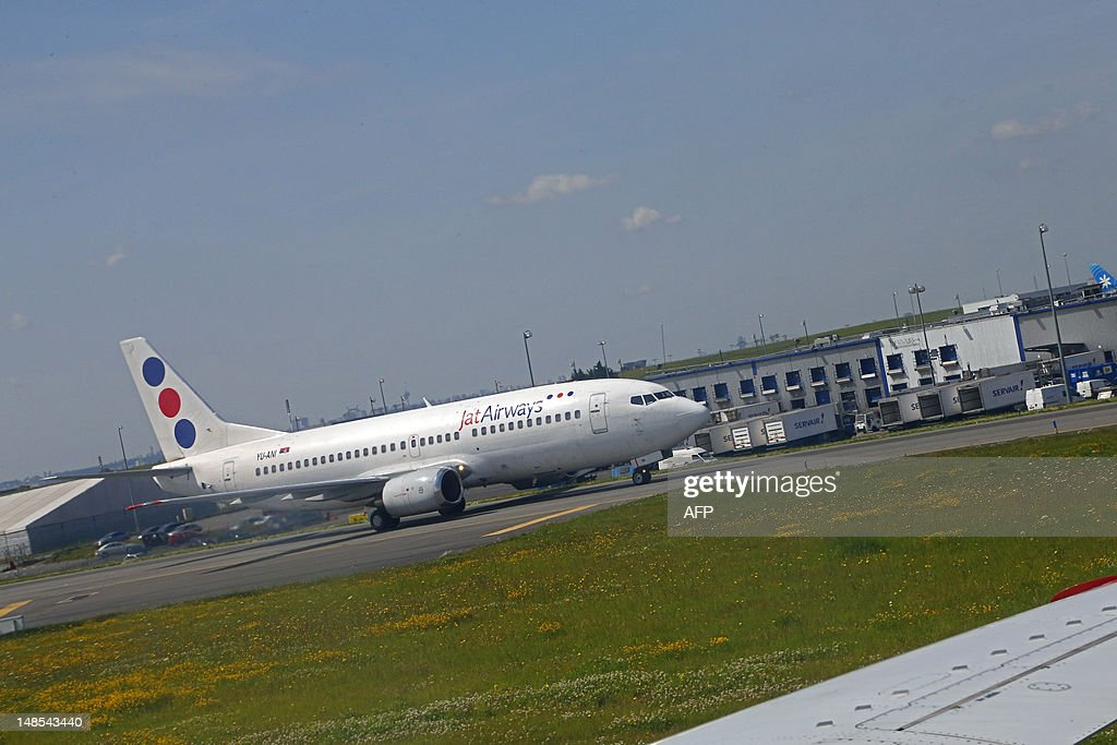 A Boeing 737 of Serbian airline company, Jat Airways is seen on taxiways prior to take off at Paris Roissy Charles de Gaulle airport in Roissy-en-France, north of Paris on July 18, 2012.