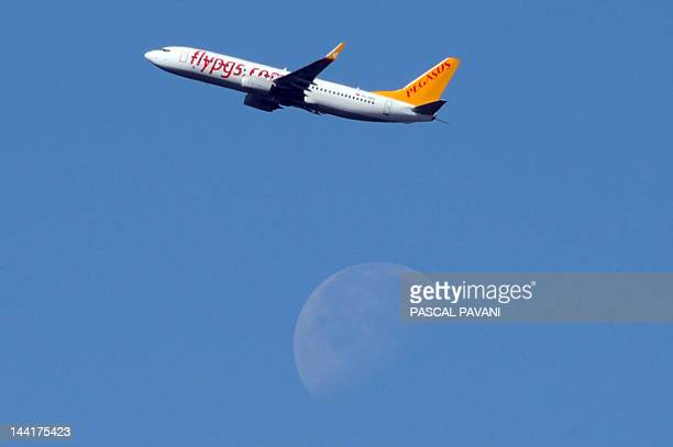 Boeing 737 of Turkish low cost airlines Pegasus flies over Toulouse's area southwestern France on May 11 2012 AFP PHOTO/PASCAL PAVANI