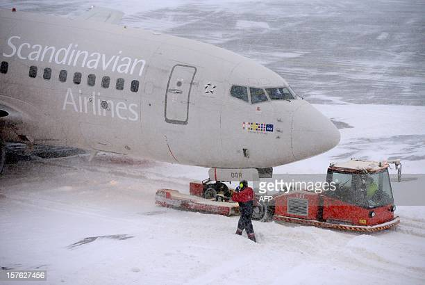 A Boeing 737600 from Scandinavian Airlines SAS is parked at terminal 5 at Arland airport outside Stockholm on December 5 2012 Only one track is open...