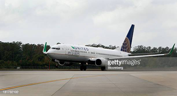 A Boeing 737800 bearing the Eco Skies livery takes off from George Bush Intercontinental Airport in Houston Texas US on Monday Nov 7 2011 United...