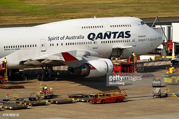 A Boeing 747 aircraft operated by Qantas Airways Ltd stands at Sydney Airport in Sydney Australia on Monday June 22 2015 Australia's central bank...
