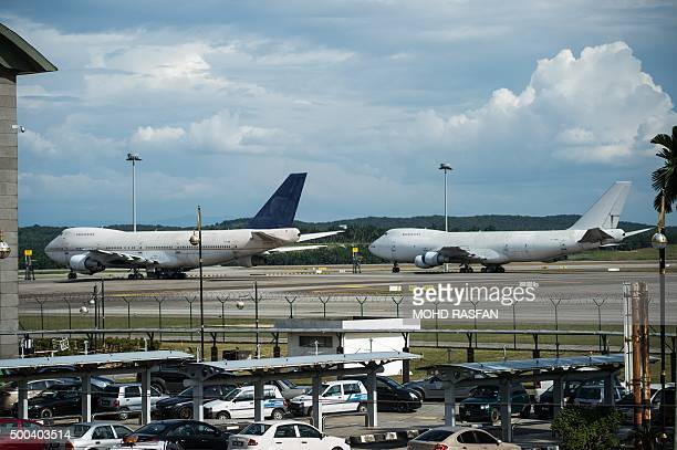 Boeing 747200F planes with the registration numbers TFARM and TFARN are seen parked on the tarmac at Kuala Lumpur International Airport in Sepang on...