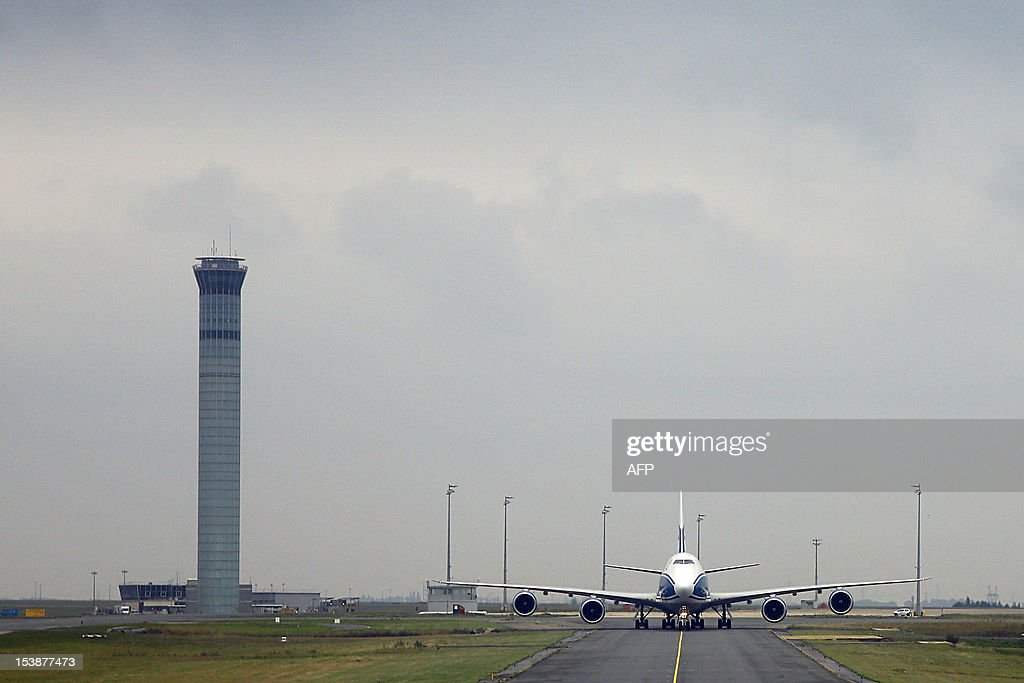 A Boeing 747-8 Freighter cargo airplane from Russian company Air Bridge Cargo uses taxiways after landing at Paris Roissy Charles de Gaulle airport in Roissy-en-France, north of Paris on October 10, 2012.