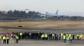 Boeing 7478 freighter lands in front of a crowd of Boeing employees and guests after its first test flight February 8 2009 at Paine Field in Everett...