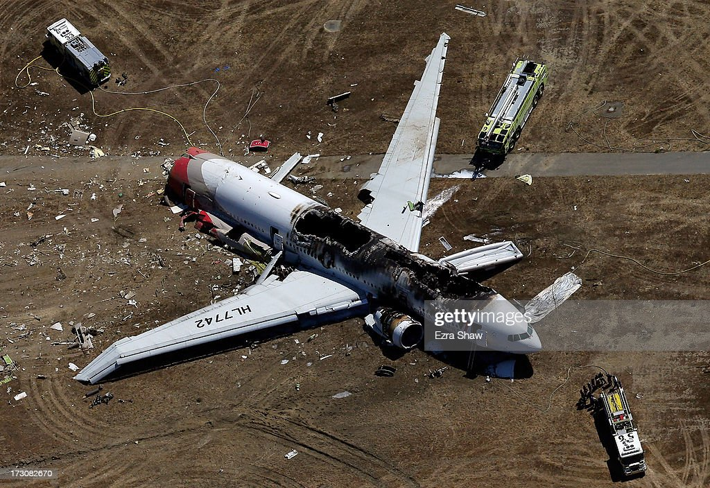 A Boeing 777 airplane lies burned on the runway after it crash landed at San Francisco International Airport July 6, 2013 in San Francisco, California. An Asiana Airlines passenger aircraft coming from Seoul, South Korea crashed while landing. There has been no official confirmation of casualties.