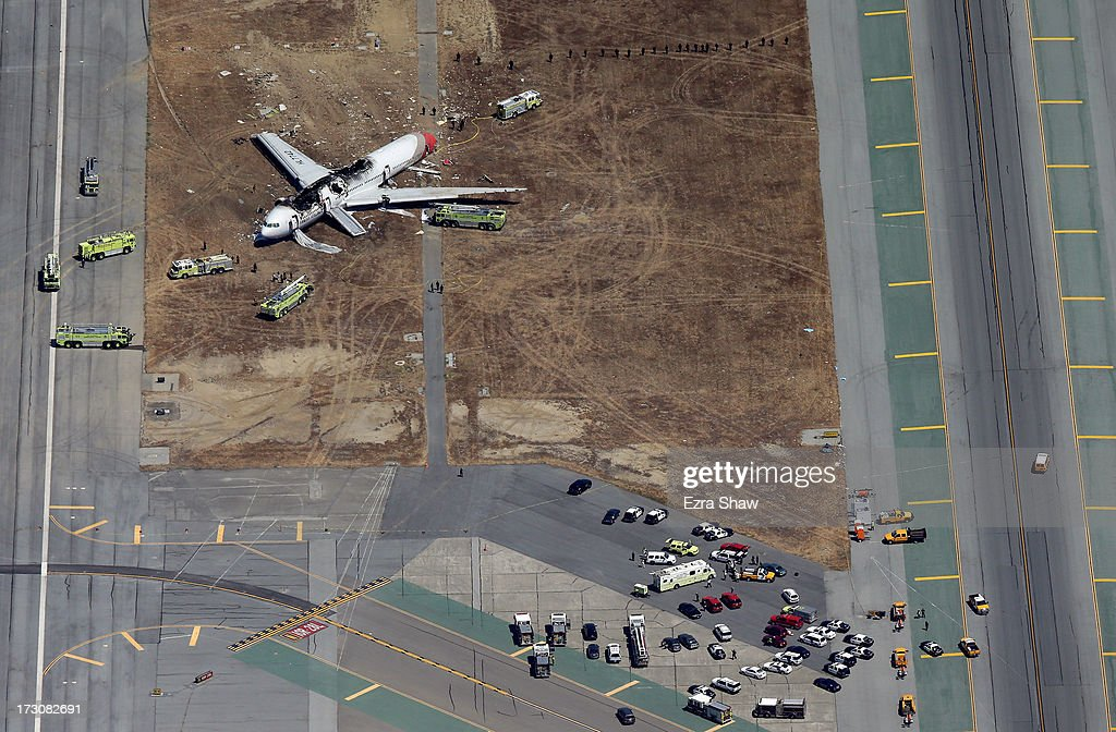 Boeing 777 airplane lies burned on the runway after it crash landed at San Francisco International Airport July 6 2013 in San Francisco California An...