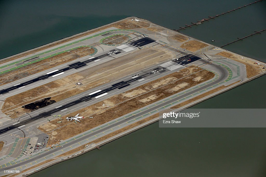 A Boeing 777 airplane lies burned on the runway after it crash landed at San Francisco International Airport July 6, 2013 in San Francisco, California. An Asiana Airlines passenger aircraft coming from Seoul, South Korea crashed while landing. There has been at least two casualties reported.