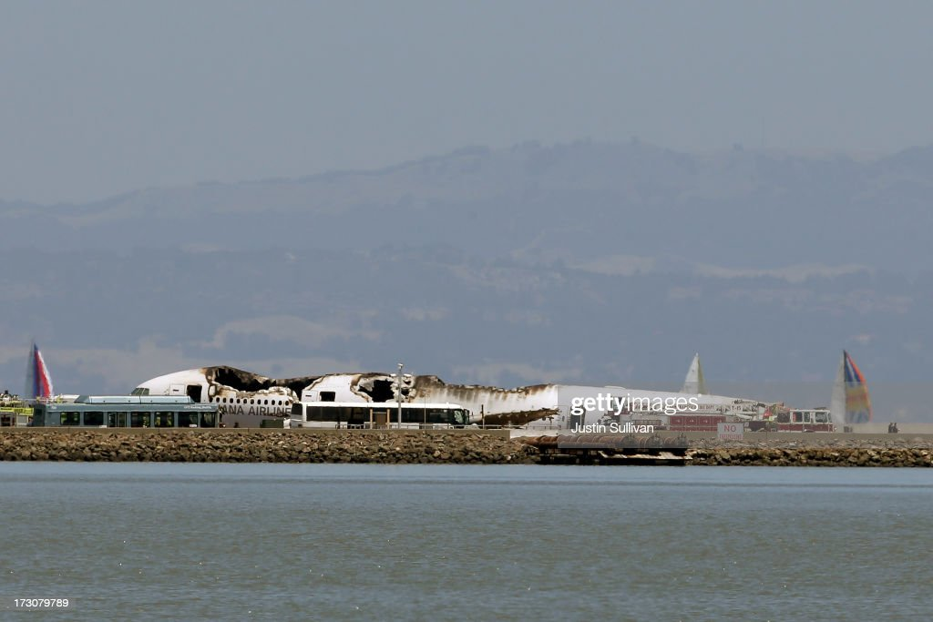 A Boeing 777 airplane lies burned on the runway after it crashed landed at San Francisco International Airport July, 6, 2013 in San Francisco, California. A passenger aircraft from Asiana Airlines coming from Seoul, South Korea crashed landed on the runway. No word so far on injuries or deaths.