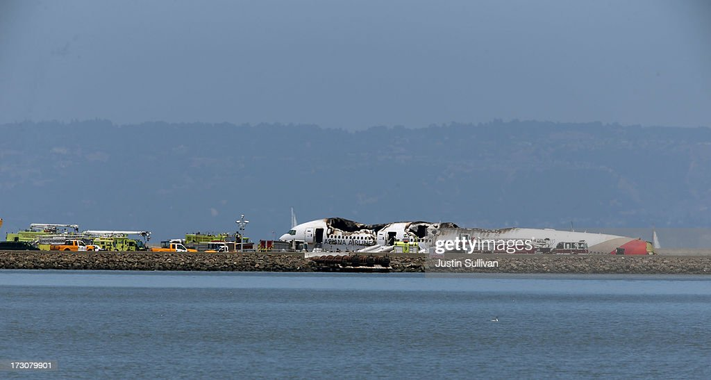 A Boeing 777 airplane lies burned on the runway after it crashed landed at San Francisco International Airport July 6, 2013 in San Francisco, California. A passenger aircraft from Asiana Airlines coming from Seoul, South Korea crashed landed on the runway. No word so far on injuries or deaths.