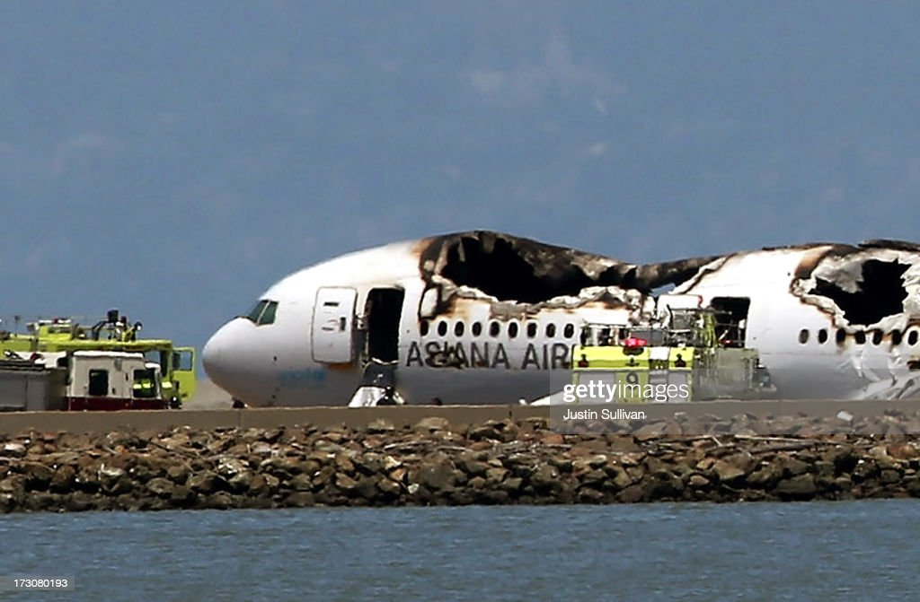 A Boeing 777 airplane lies burned on the runway after it crashed landed at San Francisco International Airport July 6 2013 in San Francisco...