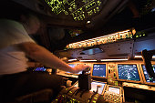 August 8, 2017 Flight from Amsterdam. Pilot enjoying the night after departure of Amsterdam International Airport Netherlands. The view from the flight deck with illuminated buttons and blurred motion