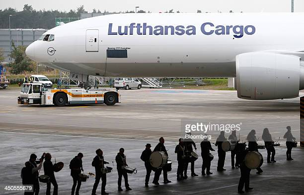 A Boeing 777F freighter aircraft operated by Lufthansa Cargo AG is pulled across the tarmac at Frankfurt airport in Frankfurt Germany on Tuesday Nov...