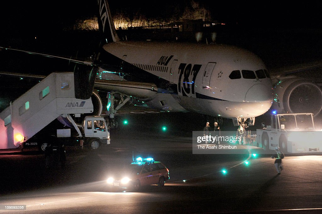 A Boeing 787 airplane is towed on the runway of Takamatsu Airport on January 16, 2013 in Takamatsu, Kagawa, Japan. All Nippon Airways flight 692, departing from Yamaguchi Ube airport at 8:10 detected smoke inside the aircraft, made an emergency landing at Takamatsu Airport on 8:45, all 137 passengers and crews evacuated from the plane.