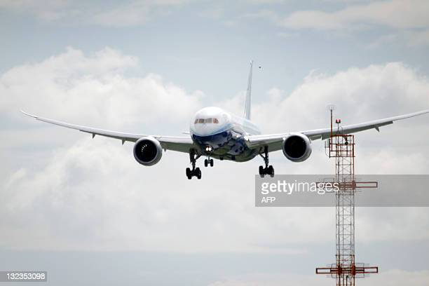 A Boeing 787 Dreamliner aircraft arrives at Auckland International Airport on November 12 2011 Boeing says the twinaisle 787's construction partly...