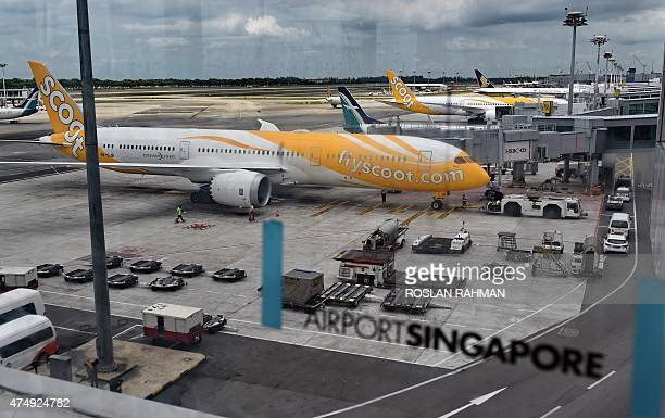 Boeing 787 Dreamliner aircraft operated by longhaul budget carrier Scoot a subsidiary of Singapore Airlines are parked on the apron with Singapore...