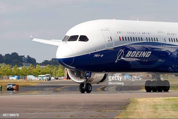 A Boeing 787 Dreamliner aircraft produced by Boeing Co taxis on the runway after performing in an aerial flying display on the second day of the...