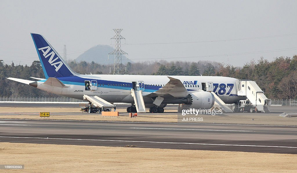 A Boeing 787 Dreamliner operated by All Nippon Airways (ANA) sits on the tarmac after an emergency landing at Takamatsu Airpirt in Takamatsu, west of Japan, on January 16, 2013. Japan's two biggest airlines on January 16 grounded all their Dreamliners in the most serious blow yet to Boeing's troubled next-generation model after an ANA flight was forced into an emergency landing. AFP PHOTO/Jiji Press JAPAN OUT