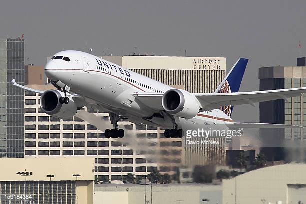 Boeing 787 Dreamliner operated by United Airlines takes off at Los Angeles International Airport on January 9 2013 in Los Angeles California Two...