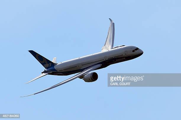 A Boeing 7879 is pictured during an air display on the second day of the Farnborough International Air show in Hampshire England on July 15 2014 The...