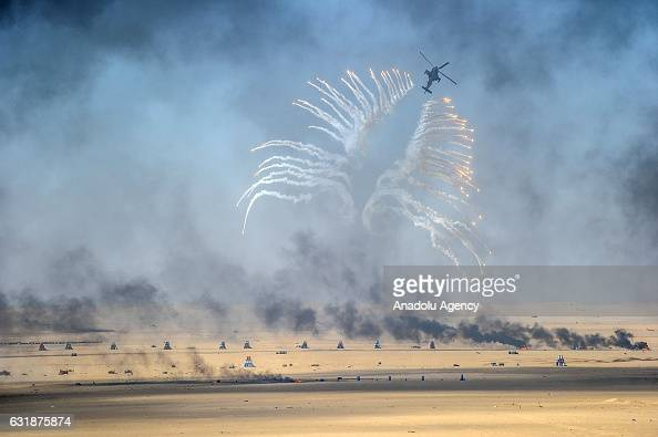 Boeing AH64 Apache helicopter salvoes flares during the Exercise Storm of 2017 in Jahra Kuwait on January 17 2017 Fighter jets and helicopters of...
