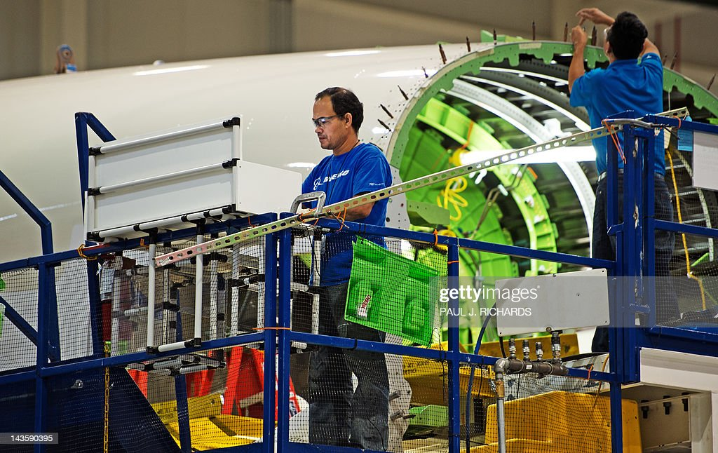 Boeing assebly line workers are seen making the Dreamliner 787 at Boeing's new production facilities April 27, 2012, in North Charleston, South Carolina. Later in the day Boeing conducted 'roll-out' ceremonies for their first South Carolina made 787 Dreamliner aircraft. AFP PHOTO/Paul J. Richards
