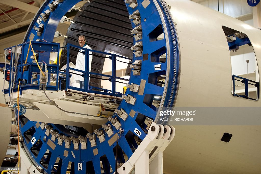A Boeing assembly lihe employee is seen working on a compnent for the Dreamliner 787 at Boeing's new production facilities April 27, 2012, in North Charleston, South Carolina. Later in the day Boeing conducted 'roll-out' ceremonies for their first South Carolina made 787 Dreamliner aircraft. AFP PHOTO/Paul J. Richards