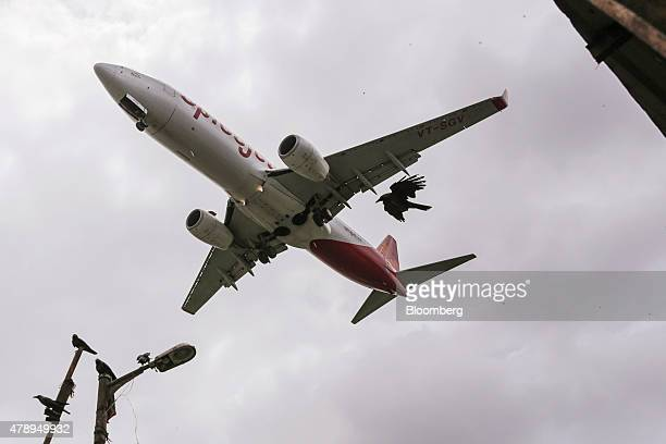 A Boeing Co 737 aircraft operated by SpiceJet Ltd approaches to land at Chhatrapati Shivaji International Airport in Mumbai India on Saturday June 27...