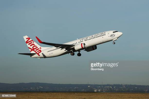 A Boeing Co 737 aircraft operated by Virgin Australia Holdings Ltd takes off from Sydney Airport in Sydney Australia on Thursday Aug 10 2017 Virgin...