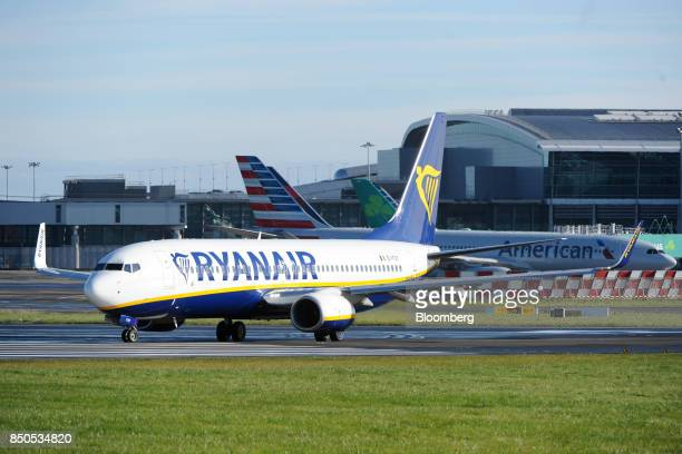 A Boeing Co 737 passenger aircraft operated Ryanair Holdings Plc taxis on the tarmac at Dublin Airport in Dublin Ireland on Thursday Sept 21 2017...