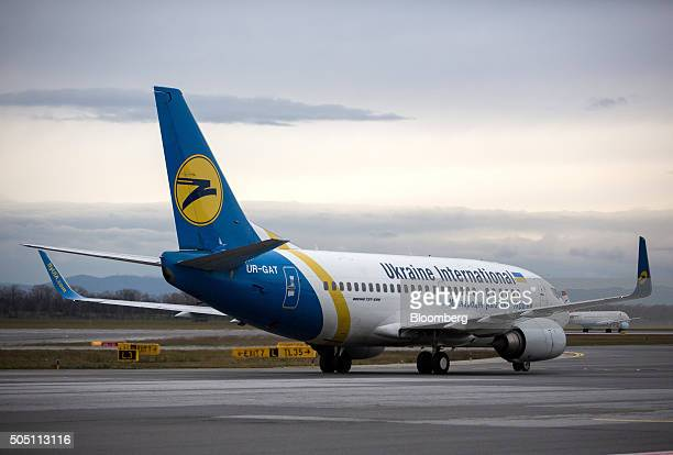 A Boeing Co 737500 aircraft operated by Ukraine International Airlines taxis to the runway at Vienna International Airport operated by Flughafen Wien...