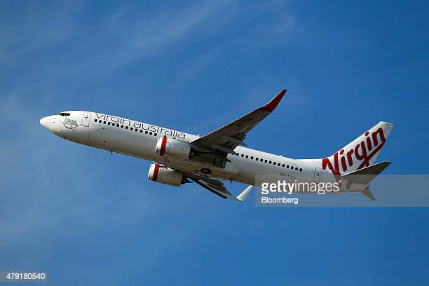 A Boeing Co 737800 aircraft operated by Virgin Australia Holdings Ltd takes off at Sydney Airport in Sydney Australia on Monday June 22 2015...