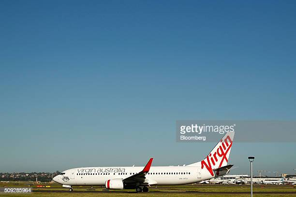 A Boeing Co 737800 aircraft operated by Virgin Australia Holdings Ltd taxis at Sydney Airport in Sydney Australia on Monday Feb 8 2016 Virgin...