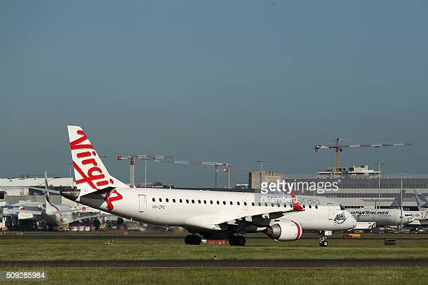 A Boeing Co 737800 aircraft operated by Virgin Australia Holdings Ltd prepares to take off at Sydney Airport in Sydney Australia on Monday Feb 8 2016...