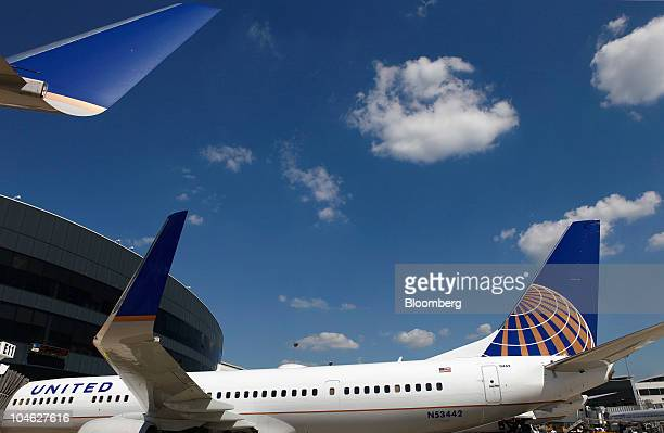 A Boeing Co 737924 extended range jet bearing United Airlines livery and the Continental Airlines logo arrives at the gate following the inaugural...