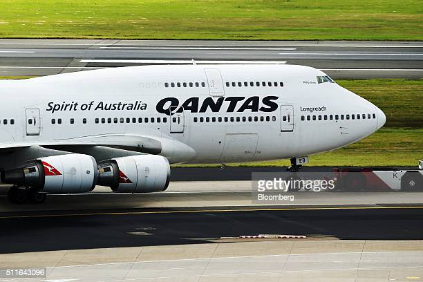 A Boeing Co 747 aircraft operated by Qantas Airways Ltd pushes back at Sydney Airport in Sydney Australia on Monday Feb 22 2016 Qantas Airways is...
