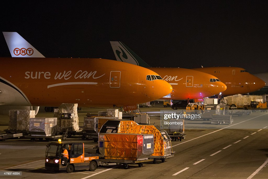 Boeing Co 747 cargo jets stand on the tarmac at TNT Express NV's European mail hub at Liege Airport in GraceHollogne Belgium on Friday July 3 2015...