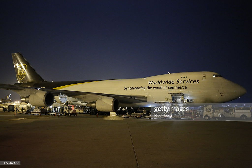 A Boeing Co. 747 is unloaded by ground crews during United Parcel Service Inc. (UPS) Worldport overnight shipping operations at Louisville International Airport in Louisville, Kentucky, U.S., on Thursday, Aug. 22, 2013. Founded 106 years ago as a bicycle messenger service, UPS now handles 16.3 million packages and documents per day and is considered an economic bellwether because of the diverse items it delivers such as industrial parts, health-care products and financial paperwork. Photographer: Luke Sharrett/Bloomberg via Getty Images