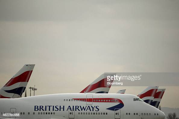 A Boeing Co 747 passenger aircraft operated by British Airways a unit of International Consolidated Airlines Group SA taxis past other British...