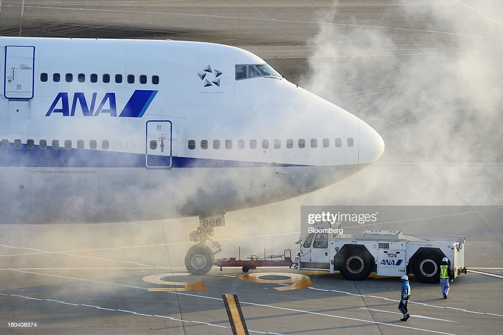 A Boeing Co. 747-400 aircraft operated by All Nippon Airways Co. (ANA) is pushed back by a tug at Haneda Airport in Tokyo, Japan, on Wednesday, Jan. 30, 2013. ANA has canceled a total of 784 flights, affecting 74,200 passengers through Feb. 12, since a Jan. 16 incident that led to the global grounding of Boeing Co. 787s, according to figures from the company. Photographer: Akio Kon/Bloomberg via Getty Images