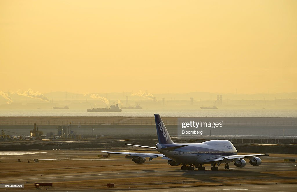 A Boeing Co. 747-400 aircraft operated by All Nippon Airways Co. (ANA) prepares to take off at Haneda Airport as the sun rises in Tokyo, Japan, on Wednesday, Jan. 30, 2013. ANA has canceled a total of 784 flights, affecting 74,200 passengers through Feb. 12, since a Jan. 16 incident that led to the global grounding of Boeing Co. 787s, according to figures from the company. Photographer: Akio Kon/Bloomberg via Getty Images