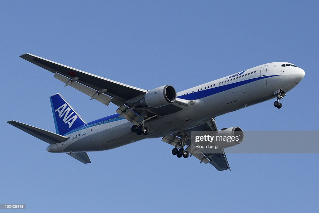 A Boeing Co. 767-300 aircraft operated by All Nippon Airways Co. (ANA) approaches to land at Haneda Airport in Tokyo, Japan, on Wednesday, Jan. 30, 2013. ANA has canceled a total of 784 flights, affecting 74,200 passengers through Feb. 12, since a Jan. 16 incident that led to the global grounding of Boeing Co. 787s, according to figures from the company. Photographer: Akio Kon/Bloomberg via Getty Images