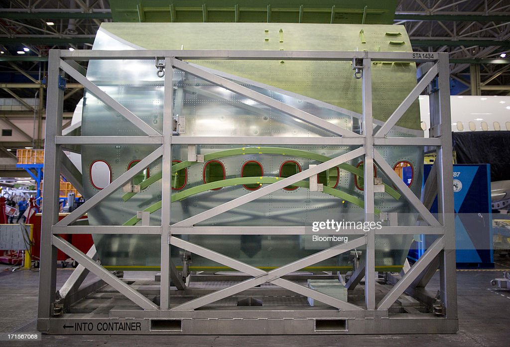Boeing Co. 777 fuselage sections are transported on racks at the company's facility in Everett, Washington, U.S., on Tuesday, June 25, 2013. Boeing Co. uses the Automated Spray Method (ASM), which consists of a robot with two guns that applies two paints at different thicknesses, to efficiently paint the wings of the popular 777 airplanes. Photographer: Mike Kane/Bloomberg via Getty Images