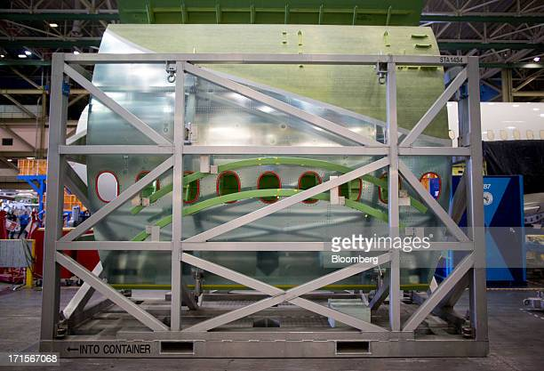 Boeing Co 777 fuselage sections are transported on racks at the company's facility in Everett Washington US on Tuesday June 25 2013 Boeing Co uses...