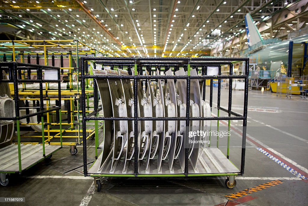 Boeing Co. 777 window panels await installation at the company's facility in Everett, Washington, U.S., on Tuesday, June 25, 2013. Boeing Co. uses the Automated Spray Method (ASM), which consists of a robot with two guns that applies two paints at different thicknesses, to efficiently paint the wings of the popular 777 airplanes. Photographer: Mike Kane/Bloomberg via Getty Images