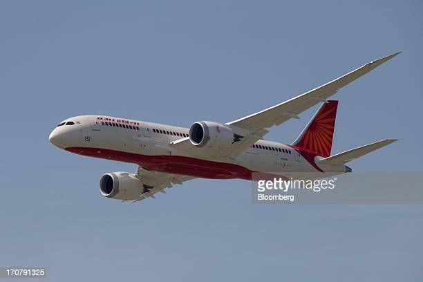 A Boeing Co 787 Dreamliner aircraft operated by Air India Ltd participates in a flying display on the first day of the Paris Air Show in Paris France...